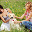 Girlfriends and dog — Stock Photo #8941407