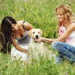 Girlfriends and dog — Stock Photo #8941411