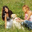 Girlfriends and dog — Stockfoto