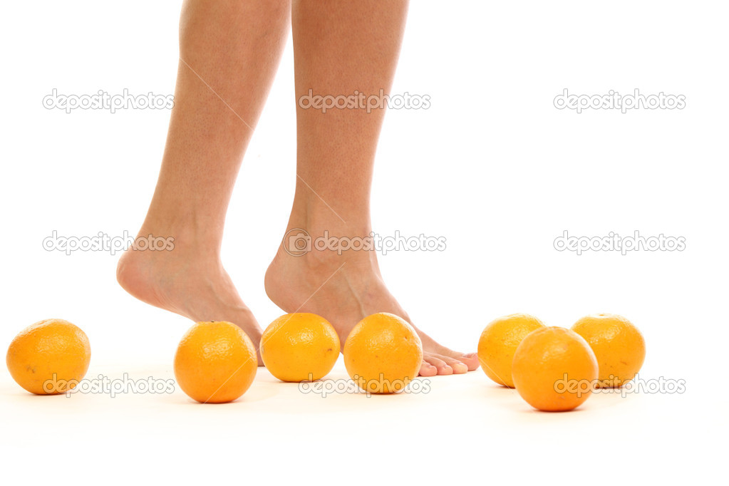 Leg and oranges isolated white background — Stock Photo #8941621
