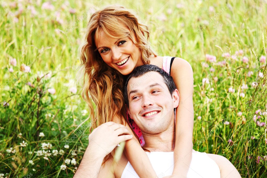 Two lovers on grass field — Stock Photo #8941626
