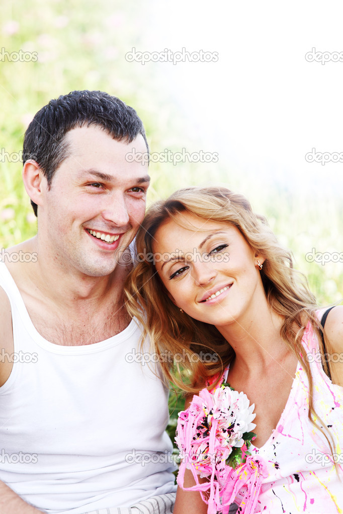 Two lovers on grass field — Stock Photo #8941639