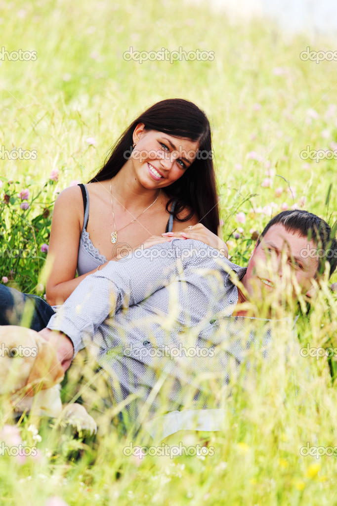Two lovers on grass field — Stock Photo #8941641