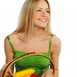 Woman holds a basket of fruit — Stock Photo #8974724