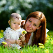 Mother and daughter on the green grass — Stock Photo #8974751