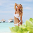 Woman on tropical beach — Stock Photo