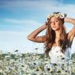 Girl in dress on the daisy flowers field - Stock Photo