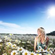 Girl in dress on the daisy flowers field — Stock Photo #9030547