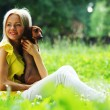 Woman dachshund in her arms - Foto Stock