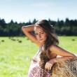 Girl next to a stack of hay — Stock Photo
