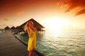 Woman in a dress on maldivian sunset — Stock Photo