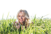 Woman on green grass — Stock Photo
