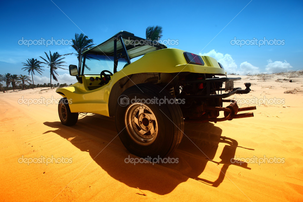 Desert buggy in desert sand under blue sky — Stock Photo #9053335