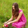 Girl grow flower — Stock Photo #9067815