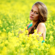 Woman on oilseed field — Foto Stock