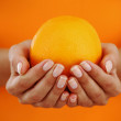 Royalty-Free Stock Photo: Orange in woman hands