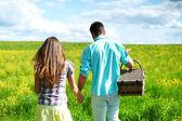 Lovers hug on picnic — Stock Photo