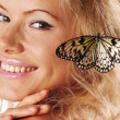Woman and butterfly — Stock Photo #9147682