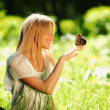 Woman playing with a butterfly — Stock Photo #9148013