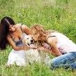 Girlfriends and dog — Stock Photo #9252557