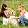 Girlfriends and dog — Stock Photo #9252559