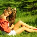 Woman on green grass — Stock Photo #9253076