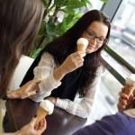 Women licking ice cream — Stock Photo