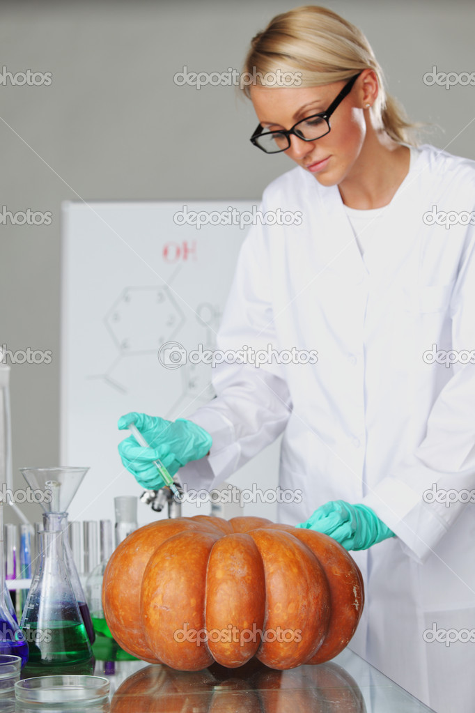 Scientist conducting genetic experiment with pumpkin — Stock Photo #9462581