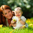 Mother and daughter on the green grass — Stock Photo #9495592