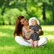 Mother and daughter on the green grass — Stock Photo #9495599