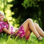 Girl lying under a tree — Stock Photo