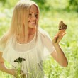 Woman playing with a butterfly — Stock Photo