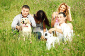 Friends and dog — Stockfoto