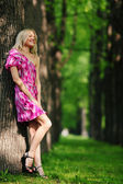 Woman on a shady park alley — Stock Photo