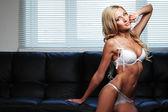Sexy woman on sofa — Stock Photo