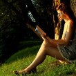 Stock Photo: Woman reading a book in park