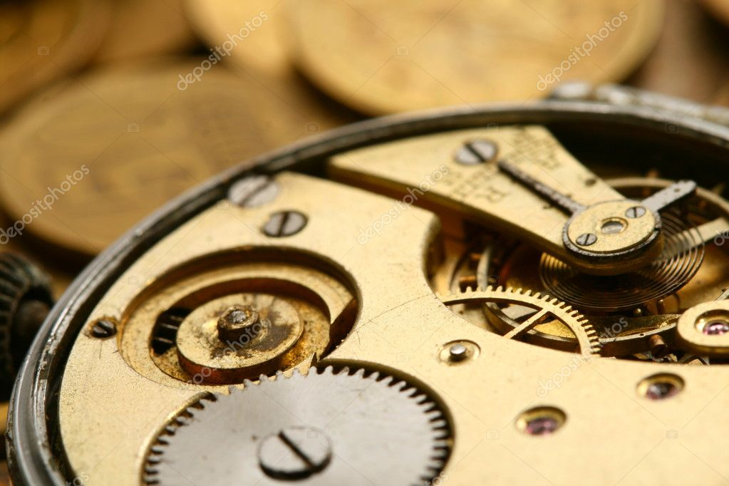 Time is money coins and clock macro concet — Stock Photo #9799234
