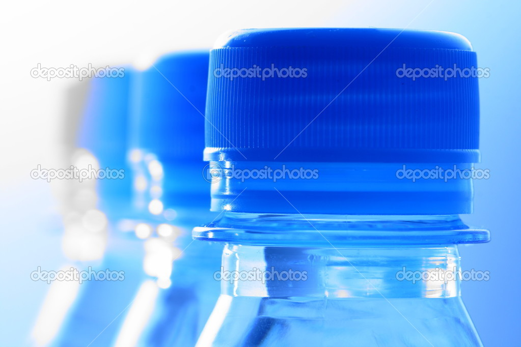 Clear cold blue water in bottle — Stock Photo #9799276