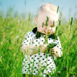 Boy in grass call by phone — Stock Photo