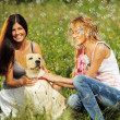 Girlfriends and dog - Stock Photo