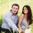 Lovers on grass field — Stock Photo #9886018