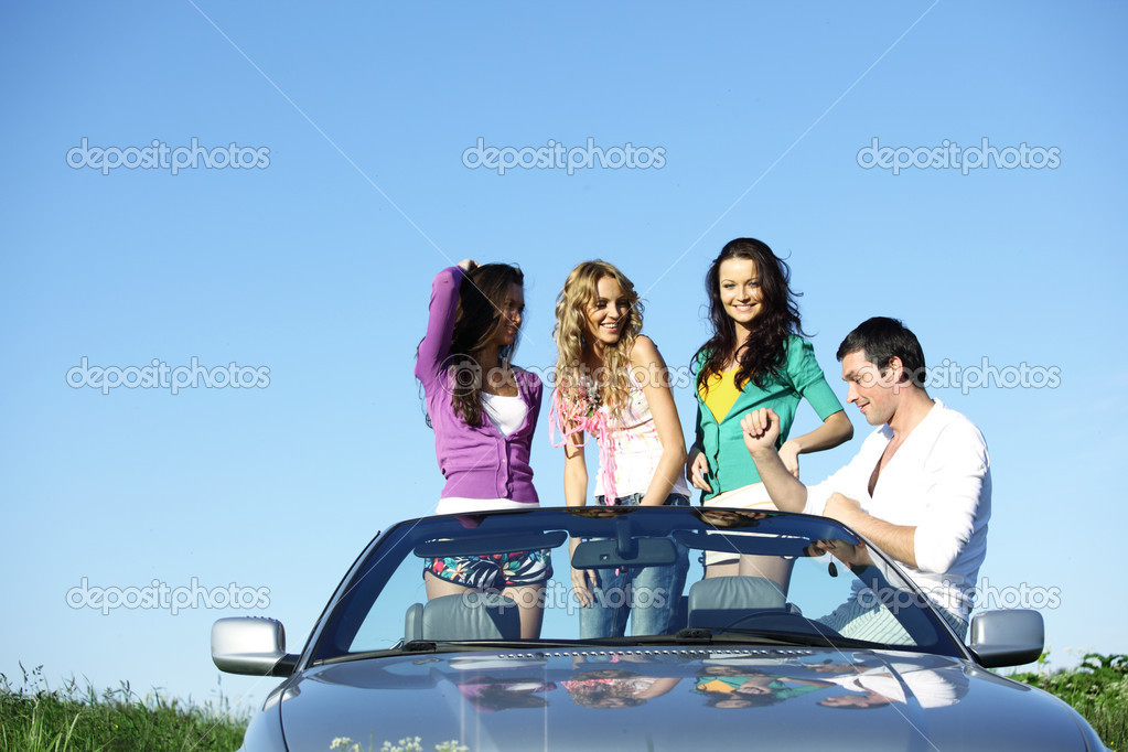 Funey friends in dance car — Stock Photo #9886226