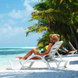 Tropical woman on lounge — Stock Photo #9974623