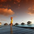 Woman in a dress on maldivian sunset — Stock Photo #9974640