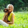 Woman dachshund in her arms - Stock Photo