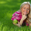 Stock Photo: Blonde on green grass