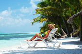 Tropical woman on lounge — Stock Photo