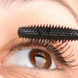 Putting mascara closeup — Stock Photo #9989779