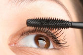 Putting mascara closeup — Stock Photo