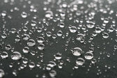 Waterdrops on gray surface — Stock Photo